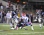 Ole Miss' Charles Sawyer (3) tackles Louisiana Tech's Quinton Patton (4) in Oxford, Miss. on Saturday, November 12, 2011.