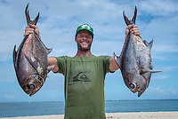 Namotu Island Resort, Nadi, Fiji (Tuesday, February 14 2017):  Skip with two Pomfreys- deep sea fish. There was virtually no wind to start the day. The ocean was so glassy with a very small left over West swell. Guests surfed Despos and Wilkes on the early morning high tide while others went fishing.   Photo: joliphotos.com