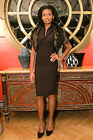 Model poses in an outfit from the Romas by Linda Rowe Thomas, Fall/Winter 2011 collection, during New York Fashion Week.