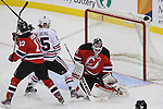 Mar 27; Newark, NJ, USA; New Jersey Devils goalie Martin Brodeur (30) makes a save while New Jersey Devils defenseman Peter Harrold (10) and Chicago Blackhawks left wing Viktor Stalberg (25) during the third period at the Prudential Center. The Devils defeated the Blackhawks 2-1 in an overtime shootout.