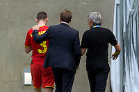 Thomas Vermaelen of Belgium is taken off injured