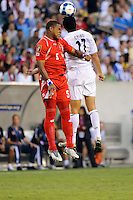 Roman Torres (5) of Panama and Brian Ching (11) of the United States (USA). The United States (USA) defeated Panama (PAN) 2-1 during a quarterfinal match of the CONCACAF Gold Cup at Lincoln Financial Field in Philadelphia, PA, on July 18, 2009.
