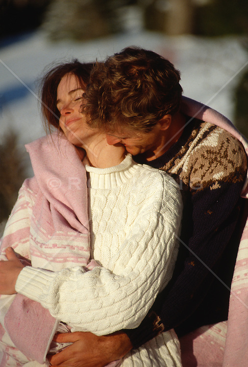 Couple Outdoors in Sweaters and a blanket  together