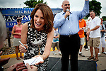 Republican presidential candidate, Rep. Michele Bachmann signs autographs at a campaign stop held at a Pizza Ranch in Newton, Iowa, August 5, 2011.