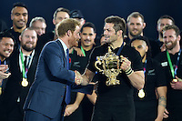 Richie McCaw of New Zealand shakes hands with Prince Harry on the winners' podium. Rugby World Cup Final between New Zealand and Australia on October 31, 2015 at Twickenham Stadium in London, England. Photo by: Patrick Khachfe / Onside Images