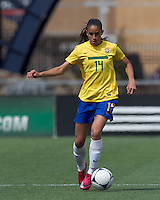 Brazilian defender Rafaelle Sousa (14) brings the ball forward. In an international friendly, Canada defeated Brasil, 2-1, at Gillette Stadium on March 24, 2012.