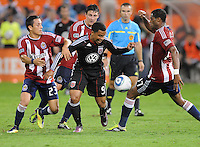 D.C. United forward Charlie Davies (9) tries to get control of the ball against Chivas USA forward Marcos Mondaini (23) left and defender David Junior Lopes (77). Chivas USA tied D.C. United 2-2 at RFK Stadium, Wednesday  September 20 , 2011.