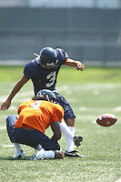 Vic Hall holds the ball for Virginia quarterback Riko Smalls during open spring practice for the Virginia Cavaliers football team August 7, 2009 at the University of Virginia in Charlottesville, VA. Photo/Andrew Shurtleff