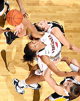 Dec. 18, 2010; Charlottesville, VA, USA; Virginia Cavaliers center Simone Egwu (4) grabs a rebound in front of UMBC Retrievers 6-0 Meghan Colabella forward (10) and UMBC Retrievers guard Michelle Kurowski (20) during the game at the John Paul Jones Arena. Virginia won 61-46. Mandatory Credit: Andrew Shurtleff