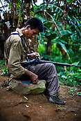 The villagers from Mabauram village are seen fixing his ancient hunting gun, while patrolling and providing security to other villagers while they go to collect vegetables and other personal items from their burnt village. Ethnic clashes are regularly taking place between Zeme Nagas and the Dimasa tribe in North Cachar Hills. Suspected Dimasa group killed 2 youths (aged 16 and 14) and burnt 21 houses out of 25 in village Mabauram in the outskirts of Haflong, Assam, India.