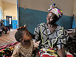 In a clinic of the United Methodist Church in Kananga, a town in the Democratic Republic of the Congo, Wafua Tshiunza cares for her 3-year old granddaughter, Any Ngalula.