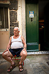 Photo of an old man sitting in Vernazza, Italy.