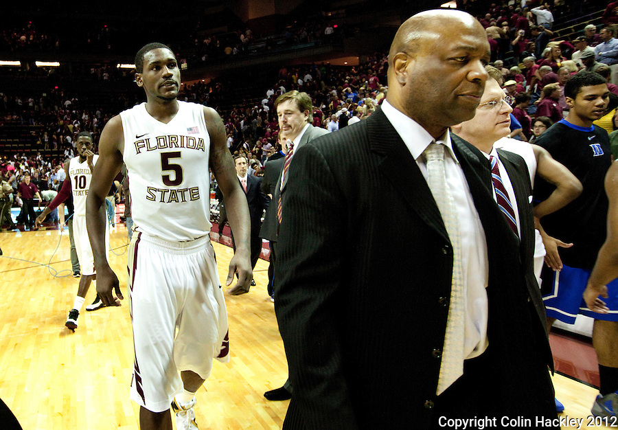 TALLAHASSEE, FLA. 2/23/12-FSU-DUKE022312 CH-FSU Coach Leonard Hamilton and Bernard James walk off the court after loosing to Duke 74-66, Feb. 23, 2012 in Tallahassee. .COLIN HACKLEY PHOTO