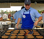 30 June 2007: Vermont Lake Monsters staffer Patrick flips burgers at a game against the Lowell Spinners at Historic Centennial Field in Burlington, Vermont. The Spinners defeated the Lake Monsters 8-4 in the last game of their 3-game NY Penn-League series...Mandatory Photo Credit: Ed Wolfstein Photo
