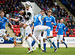 St Johnstone v Inverness Caley Thistle...02.05.15   SPFL<br /> James Vincent clears from Tam Scobbie<br /> Picture by Graeme Hart.<br /> Copyright Perthshire Picture Agency<br /> Tel: 01738 623350  Mobile: 07990 594431