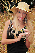Beautiful lady in a field Stock Photo