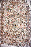 Christian funerary Mosaic of Matziceus who was from Libyia and this funerary mosaic reads, ' the faithful Matziceus lived in peace for 42 years, rested on the fifteenth of the calends of June'. The mosaic depicts two tendrils of vine thrusting out of a cantharus with peacocks & birds. This early Christian mosaic is from Demna Parish Church, left aisle, 5th century AD. Roman mosaics from the north African Roman province of Africanus . Bardo Museum, Tunis, Tunisia.