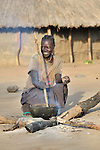 Jennifer Keji, a United Methodist, starts her day by cooking early in the morning in the Southern Sudan village of Kupera. Families here returned from refuge in Uganda in 2006 following the 2005 Comprehensive Peace Agreement between the north and south.