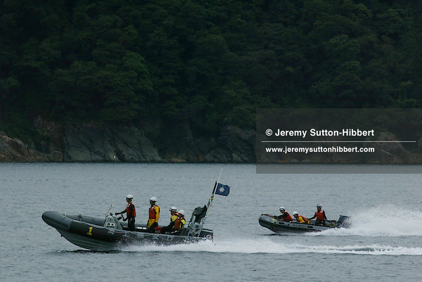 MILITARY/POLICE/COAST GUARD MANOUVERS IN TAKAHAMA BAY, JAPAN. 010702..PIC &copy; JEREMY SUTTON-HIBBERT/GREENPEACE 2002..*****ALL RIGHTS RESERVED. RIGHTS FOR ONWARD TRANSMISSION OF ANY IMAGE OR FILE IS NOT GRANTED OR IMPLIED. CHANGING COPYRIGHT INFORMATION IS ILLEGAL AS SPECIFIED IN THE COPYRIGHT, DESIGN AND PATENTS ACT 1988. THE ARTIST HAS ASSERTED HIS MORAL RIGHTS. *******