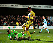 15.01.2013. Torquay, England. Exeter goalkeeper Artur Krysiak saves at the feet of Ryan Jarvis during the League Two game between Torquay United and Exeter City from Plainmoor.