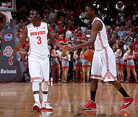 Ohio State Buckeyes guard Shannon Scott (3) and Ohio State Buckeyes forward Sam Thompson (12) celebrate at the end of Friday's NCAA Division I basketball game against against the Louisiana-Monroe Warhawks at Value City Arena in Columbus on December 27, 2013. Ohio State won the game 71-31. (Barbara J. Perenic/The Columbus Dispatch)