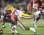LSU cornerback Tyrann Mathieu (7) breaks up a pass thrown to Ole Miss' Nickolas Brassell (2) at Vaught-Hemingway Stadium in Oxford, Miss. on Saturday, November 19, 2011. (AP Photo/Oxford Eagle, Bruce Newman).