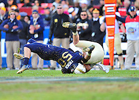 Brye French of the Navy tackles Army's Trent Steelman. Navy Midshipmen defeated Army Black Knights 27-21 during the Army vs. Navy game at the FedEx field in Landover, MD on Saturday, December 10, 2011. Alan P. Santos/DC Sports Box