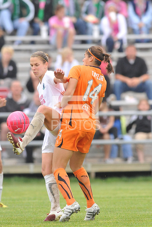 Lindsay Tarpley,Brittany Taylor #14...Saint Louis Athletica and Sky Blue FC played to a 2-2 tie at Anheuser-Busch Soccer Park, Fenton, MO...Athletica wore white / pink uniforms in support of breast cancer awareness.