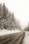 A snow and slush-covered highway in British Columbia, Canada.