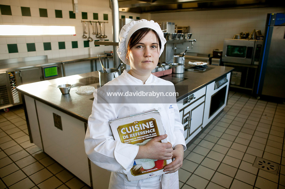 Student Pauline Meillier poses for the photographer holding Michel Maincent-Morel's book La Cuisine de Reference in a kitchen at the Ecole Superieure de Cuisine Francaise Gregoire Ferrandi cooking school in Paris, France, 18 December 2007.