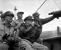 Brig. Gen. Courtney Whitney; Gen. Douglas MacArthur, Commander in Chief of U.N. Forces; and Maj. Gen. Edward M. Almond observe the shelling of Inchon from the U.S.S. Mt. McKinley, September 15, 1950.  Nutter (Army)<br /> NARA FILE #:  111-SC-348438<br /> WAR &amp; CONFLICT BOOK #:  1374