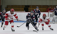 Boston, Massachusetts - December 6, 2015: NCAA Division I. Boston University (white) defeated University of Connecticut (blue), 4-3, at Walter Brown Arena.