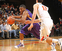 Jan. 2, 2011; Charlottesville, VA, USA; LSU Tigers guard Chris Bass (4) drives past Virginia Cavaliers guard Sammy Zeglinski (13) during the game at the John Paul Jones Arena. Mandatory Credit: Andrew Shurtleff
