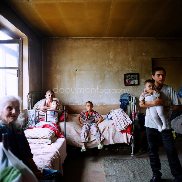Knari, 83 years old, Sevak, 24, Boris, Harutvayan and Herman  are living with 15 other members of their family in the village of Maragha where a majority of the 320 people are refugees from Baku.