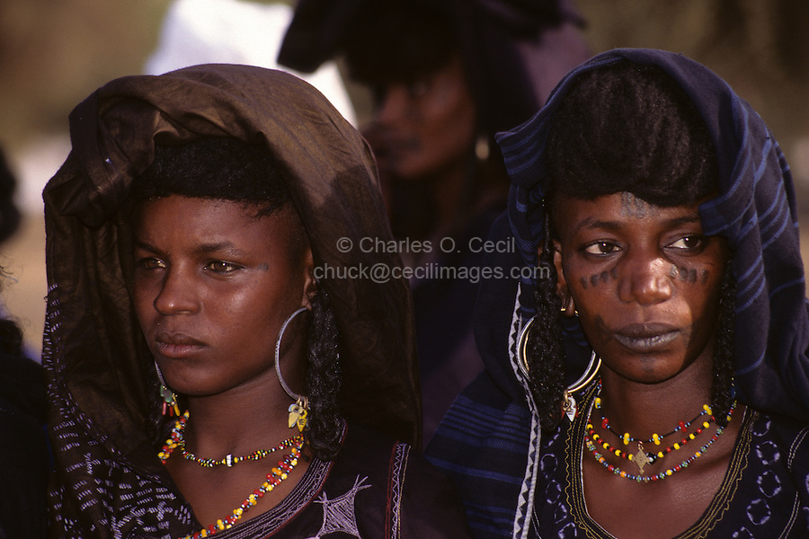 Akadaney, Niger, Africa - Fulani Wodaabe Women at Geerewol, watching Male Dancers in the Male Beauty Contest.  Note facial tattoos and scarification.