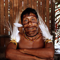 Viriunaveteri, Venezuela. A Yanomami tribal leader in his hut. .The village of Viriunaveteri consists of 15 huts around a muddy square. It's situated in the Venezuelan Amazone several days by boat from the nearest town. This community on the banks of the Casiquiare is one of the few Yanomami villages that actually has some contact with the outside world. Most other tribes live deeper in the jungle.