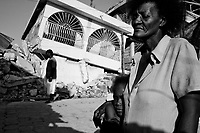 Port Au Prince, Haiti, Jan 21 2010.Gisele Dimance, 53, with her grand daughter jennifer Gilot in front of their destroyed home. The quartier Bel Air, a poor area of Port au Prince has been severely damaged. No aid or assistance has reached it yet..