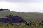 The peloton on the white gravel raods of Tuscany during the 2017 Strade Bianche running 175km from Siena to Siena, Tuscany, Italy 4th March 2017.<br /> Picture: Heinz &amp; Sabine Zwicky/Radsport.ch | Newsfile<br /> <br /> <br /> All photos usage must carry mandatory copyright credit (&copy; Newsfile | Heinz &amp; Sabine Zwicky/Radsport.ch)