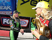 Feb 26, 2017; Chandler, AZ, USA; NHRA top fuel driver Brittany Force (left) congratulate Leah Pritchett as she celebrates after winning the Arizona Nationals at Wild Horse Pass Motorsports Park. Mandatory Credit: Mark J. Rebilas-USA TODAY Sports