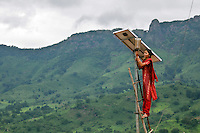 20 year old Meenakshi Diwan tends to maintenance works in the solar village Tinginapu. Meenakshi is one of four women from the village of Tinginapu who has been trained in solar powered engineering by The Orissa Tribal Empowerment and Livelihoods Programme (OTELP), an organisation funded by DFID (Department for International Development) and run with the state government of Orissa. The Orissa Tribal Women's Barefoot Solar Engineers Association has now got a contract to build 3,000 solar-powered lanterns for schools and other institutions and is training other people in the community.
