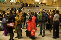 Travelers crowd Grand Central Terminal in New York on Wednesday, November 27, 2013, the beginning of the great exodus over the Thanksgiving weekend.  According to AAA, 43 million Americans will travel 50 miles or more, with Wednesday being the busiest travel day of the year.  (© Frances M. Roberts)