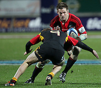 Crusaders' Richie McCaw is challenged by Chiefs' Tawera Kerr-Barlow in the semi-final Super Rugby match, Waikato Stadium, Hamilton, New Zealand, Friday, July 27, 2012.  Credit:SNPA / David Rowland