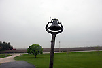 Bell in the yard outside of a farmhouse, Griffieon Family Farm, Ankeny, Iowa.