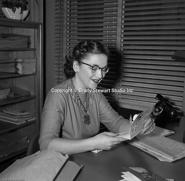 Pittsburgh PA:  Photo of Sally Stewart, office manager, for Brady Stewart Studio, Inc.  Sally was the daughter of Brady Stewart and sister of Brady Stewart Jr - 1954.