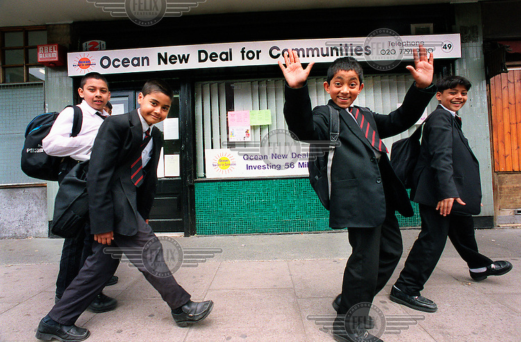 Schoolboys pass a community centre in Tower Hamlets.