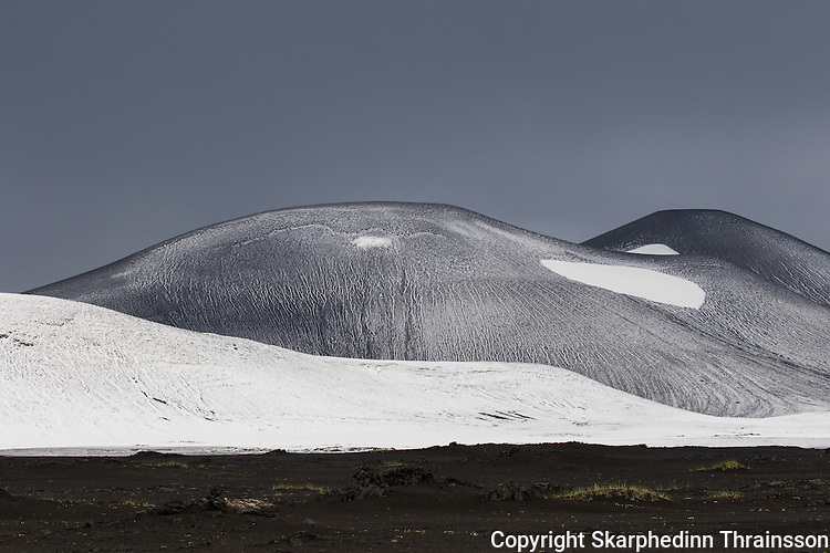 Snowy hills in Landmannalaugar nature reserve. A rear sight in july in Iceland.