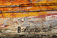 Detail of the hull of a flotsam boat in the harbour, El Jadida, Morocco. El Jadida, previously known as Mazagan (Portuguese: Mazag√£o), was seized in 1502 by the Portuguese, and they controlled this city until 1769. Picture by Manuel Cohen