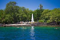 Snorkelers and Captain Cook Monument, Kealakekua Bay Marine Preserve, Captain Cook, Big Island.