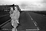 Lorraine Gilmour with daughter, wife of supergrass Raymond Gilmour.  Derry Creggan estate, Northern Ireland Londonderry.  1983.