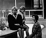 Bethel Park Senior High School:  View of students sitting in building 1's courtyard before their next class - 1964.  Students include; Cathy Stewart, Janet Watson and Leslie Staub. The new Bethel Senior High School was dedicated on October 23, 1960, but the campus would not grow to its current size until seven years later. Phase II of the construction was completed in 1964 with the addition of another academic building and the industrial arts building. Phase III was completed in 1967 with the construction of the fourth academic building and a 6,300 seat football stadium and track, three tennis courts, seven basketball courts and a baseball field.